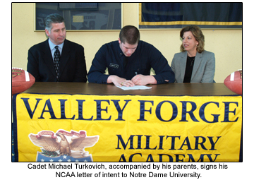 Cadet Michael Turkovich signs letter of intent.
