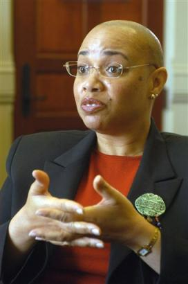 Chandra Johnson, the assistant to Notre Dame president Rev. Edward Malloy, talks about shaving her head in respone to the firing of Notre Dame football coach Tyrone Willingham in South Bend, Ind. Wednesday Dec. 8, 2004. (AP Photo/Shayna Breslin, South Bend Tribune)